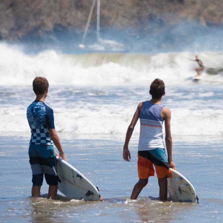 Kids surfing in Pedasí Panama
